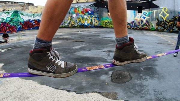 slacklining-with-shoes-sneakers-new-zealand-Gibbon-slackline-purple-surfer-Line-30-meter